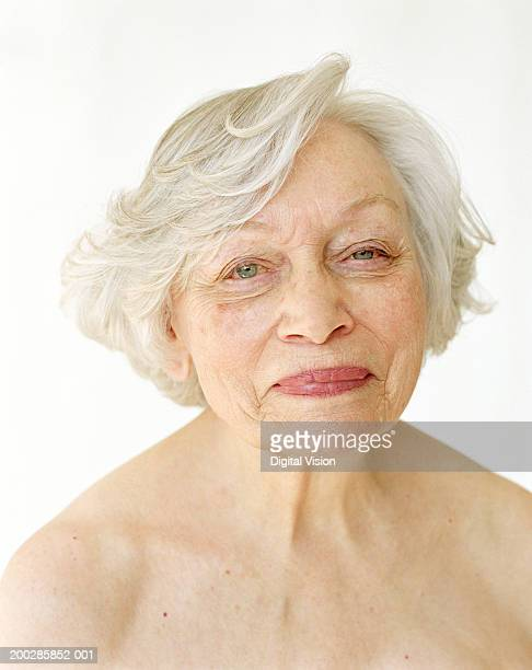 Topless senior woman smiling, portrait, close-up