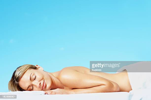 Topless sexy female rests at an outdoor spa