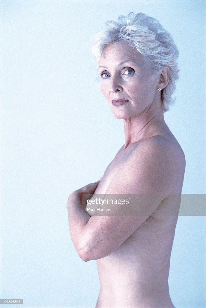 Topless Woman Covering Breasts Stock Photo | Getty Images