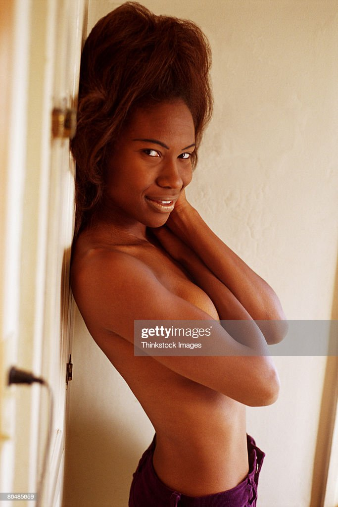 Topless woman covering chest : Stock Photo