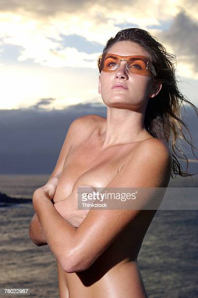 Topless woman posing modestly