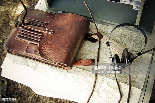 Topographic map and headphones for radio broadcasts in a German camp Second World War 20th century Historical reenactment