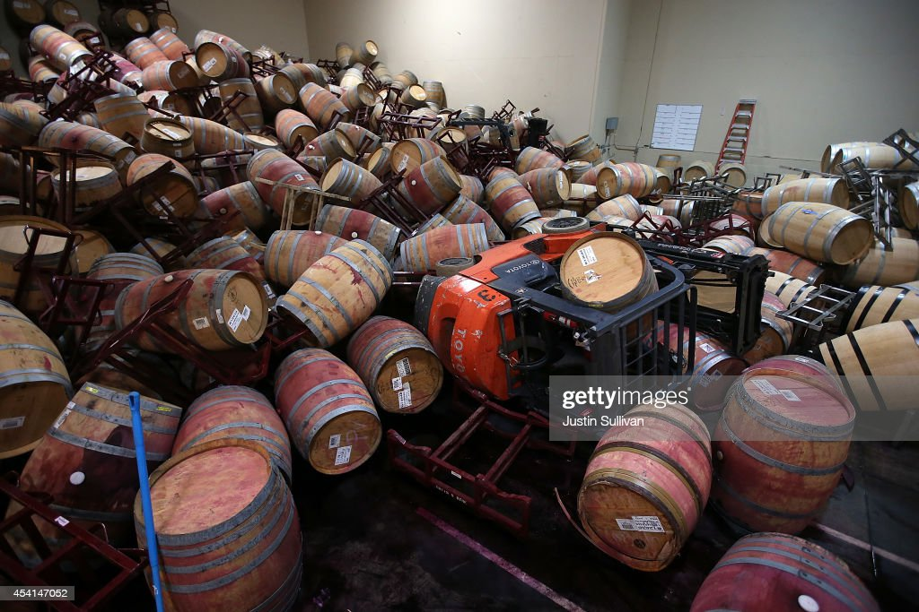 A toppled forklift sits under a pile of wine barrels that collapsed in a storage room at Kieu Hoang Winery on August 25, 2014 in Napa, California. A day after a 6.0 earthquake rocked the Napa Valley, residents and wineries are continuing clean up operations.