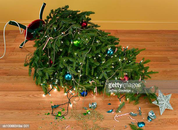 Broken christmas stock photos and pictures getty images Over the top christmas tree decorations