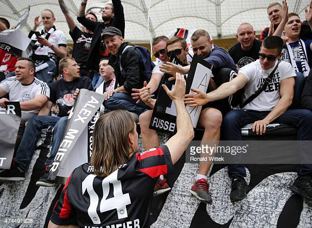 Topscorer of Frankfurt Alex Meier celebrates with fans after the Bundesliga match between Eintracht Frankfurt and Bayer 04 Leverkusen at...