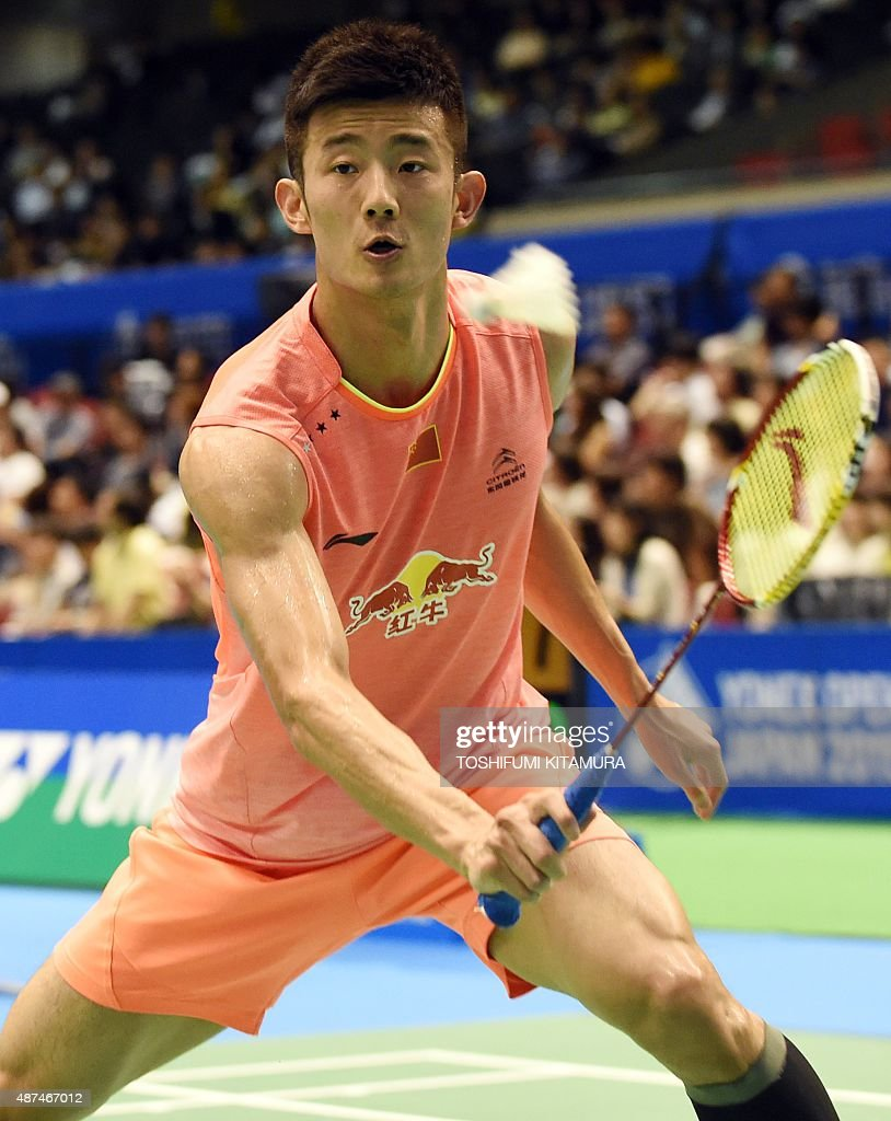 Top seeded Chen Long of China hits a return against Tian Houwei of
