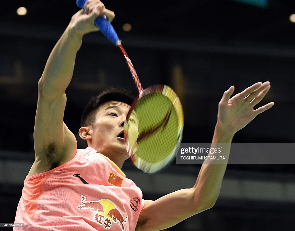Top seeded Chen Long of China hits a smash against Rajiv Ouseph of