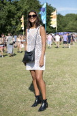 Topshop fashon buyer Louisa Falco wearing Kurt Geiger boots Topshop dress and sunglasses and a Zara bag at Lovebox 2014 on July 18 2014 in London...