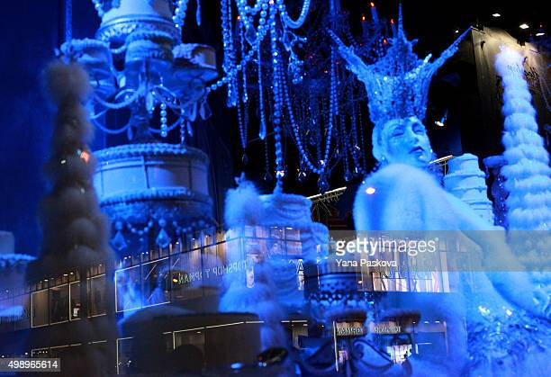 Topshop is reflected in a window showing the holiday decor of Saks Fifth Avenue in New York City on Black Friday November 27 2015 Although Black...