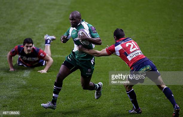 Topsy Ojo of London Irish breaks through the tackle of Clement Darbo of Agen during the European Rugby Challenge Cup match between London Irish and...