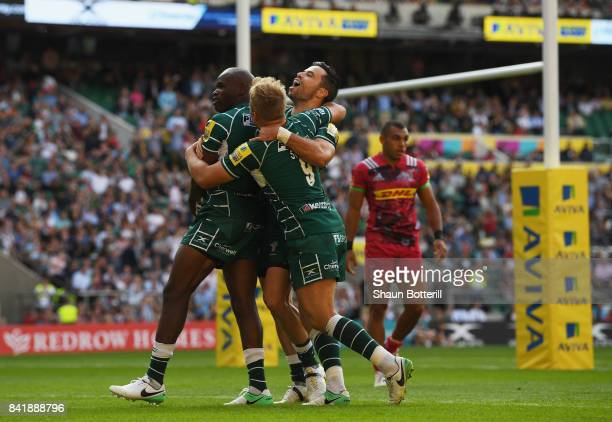 Topsy Ojo of London Irish celebrates with team mates as he scores their first try during the Aviva Premiership match between London Irish and...