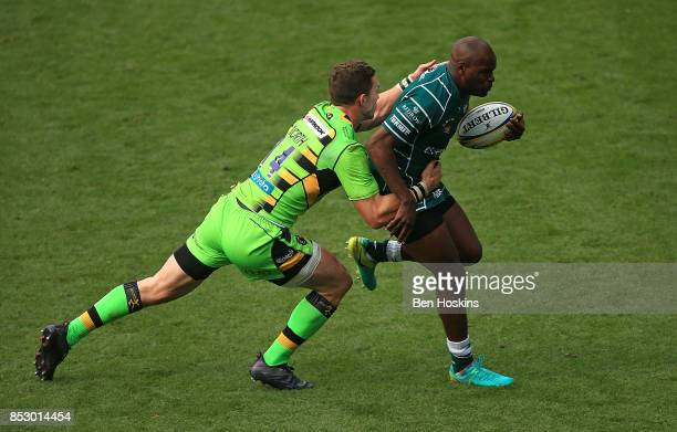 Topsy Ojo of London Irish is tackled by George North of Northampton during the Aviva Premiership match between London Irish and Northampton Saints at...
