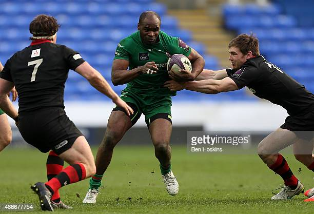 Topsy Ojo of London Irish is tackled by Tom Heathcote of Edinburgh during the European Rugby Challenge Cup Quarter Final match between London Irish...