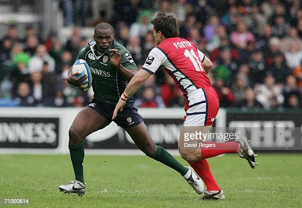 Topsy Ojo of London Irish tries to elude the tackle of Mark Foster of Gloucester during the European Challenge Cup Final match between Gloucester and...