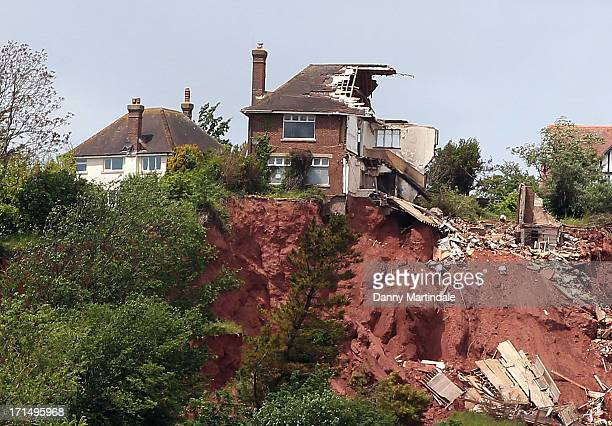 Tor Cottage a four bedroom clifftop home worth £400000 is seen on June 20 2013 in Torquay England It is on the market for a mere £25000 as it is at...