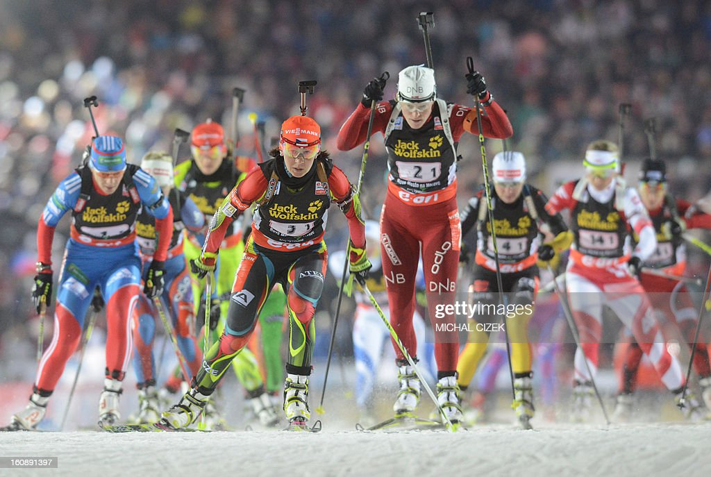 Tora Berger of Norway (C) leads a pack during the mixed 2x6+2x7,5 km relay as part of IBU Biathlon World Championships in Nove Mesto, Czech Republic, on February 7, 2013.Norway's biathlon team won this competition ahead of the team of France and Czech Republic.