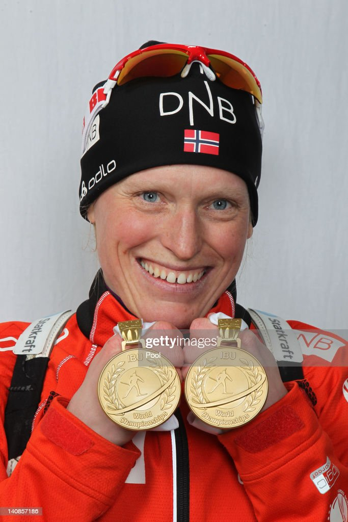 <a gi-track='captionPersonalityLinkClicked' href=/galleries/search?phrase=Tora+Berger&family=editorial&specificpeople=812729 ng-click='$event.stopPropagation()'>Tora Berger</a> of Norway poses with her gold medals after winning the Women's 15km Individual during the IBU Biathlon World Championships at Chiemgau Arena on March 7, 2012 in Ruhpolding, Germany.