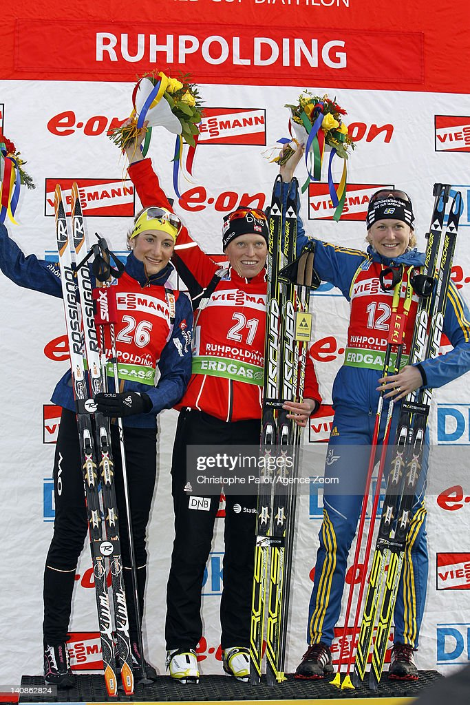 <a gi-track='captionPersonalityLinkClicked' href=/galleries/search?phrase=Tora+Berger&family=editorial&specificpeople=812729 ng-click='$event.stopPropagation()'>Tora Berger</a> of Norway takes 1st place, <a gi-track='captionPersonalityLinkClicked' href=/galleries/search?phrase=Marie+Laure+Brunet&family=editorial&specificpeople=4691768 ng-click='$event.stopPropagation()'>Marie Laure Brunet</a> of France takes 2nd place, <a gi-track='captionPersonalityLinkClicked' href=/galleries/search?phrase=Helena+Ekholm&family=editorial&specificpeople=4076012 ng-click='$event.stopPropagation()'>Helena Ekholm</a> of Sweden takes 3rd place during the IBU Biathlon World Championships Women's Distance on March 07, 2012 in Ruhpolding, Germany.