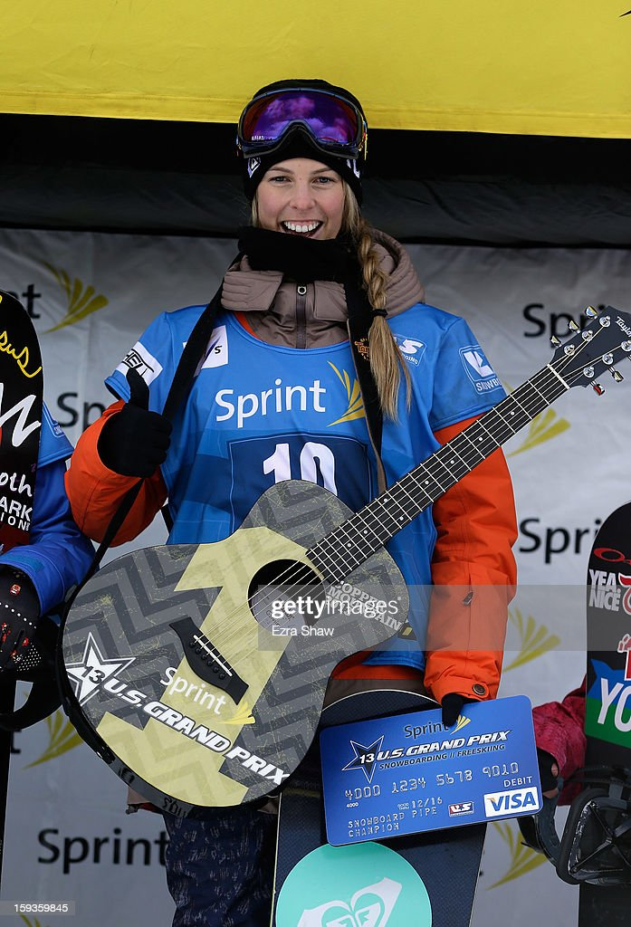 Torah Bright of Australia stands on the podium after winning the FIS Snowboard World Cup Half Pipe ladies' final at the US Grand Prix on January 12, 2013 in Copper Mountain, Colorado.