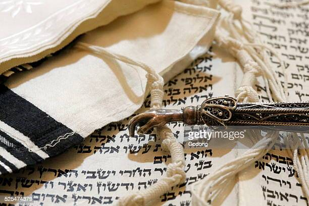 Torah scroll Yad Torah pointer and Tallit Jewish prayer shawl
