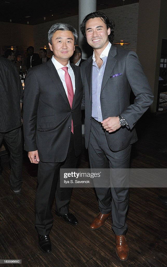 Toranosuke Matsuoka (R) and Kemji Yoshikawa pose for a photo with a guest as DuJour's Jason Binn & Toranosuke Matsuoka debut the new fall homecoming menu at SEN NYC on October 7, 2013 in New York City.