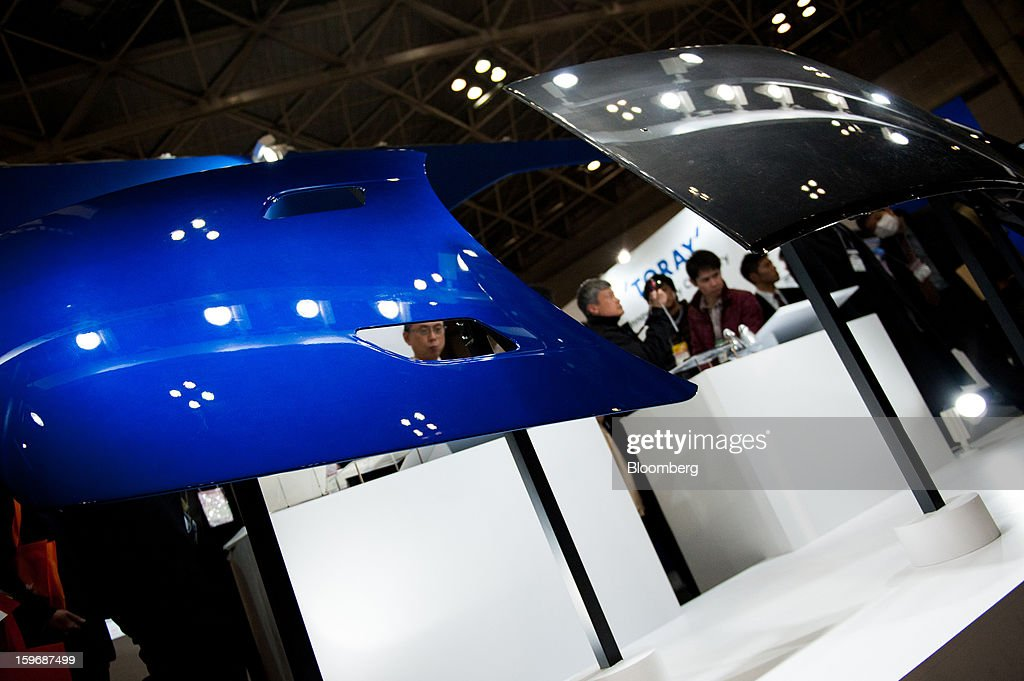 Toray Industries Inc. carbon fiber reinforced plastic (CFRP) hoods are displayed at Automotive World 2013 in Tokyo, Japan, on Friday, Jan. 18, 2013. The Automotive World 2013 trade show ends today. Photographer: Noriko Hayashi/Bloomberg via Getty Images