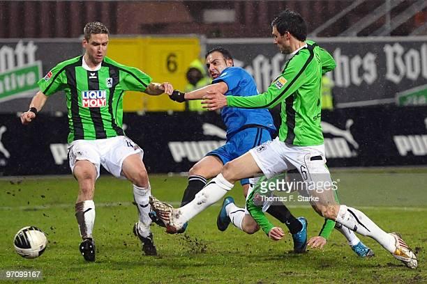 Torben Hoffmann and Mathieu Beda of Munich tackle Mahir Saglik of Paderborn during the Second Bundesliga match between SC Paderborn and 1860 Muenchen...