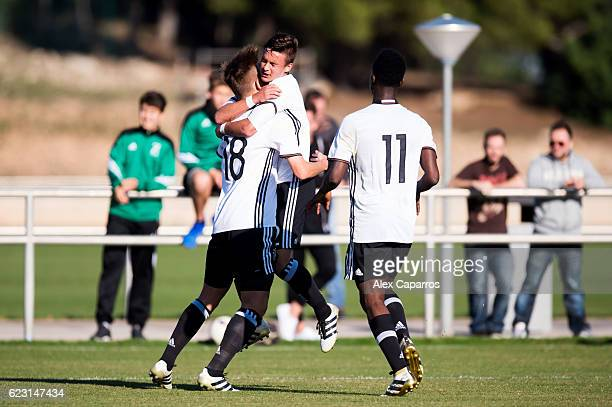 Torben Musel of Germany celebrates with his teammates Gabriel Kyeremateng and MarvinLee Rittmuller after scoring his team's second goal during the...