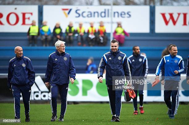 Torben Storm 2nd assistant coach Morten Olsen head coach of Denmark and Goalkeeper Stephan Andersen walks on to the pitch prior to the Denmark...
