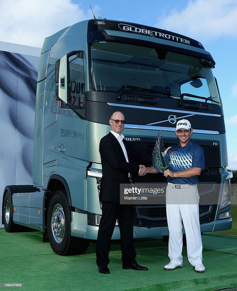 Torbjorn Christensson, President, Volvo Group Southern Africa and Louis Oosthuizen of South Africa pose for a picture afterthe final round of the Volvo Golf Champions at Durban Country Club on January 13, 2013 in Durban, South Africa.