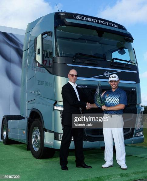 Torbjorn Christensson President Volvo Group Southern Africa and Louis Oosthuizen of South Africa pose for a picture afterthe final round of the Volvo...
