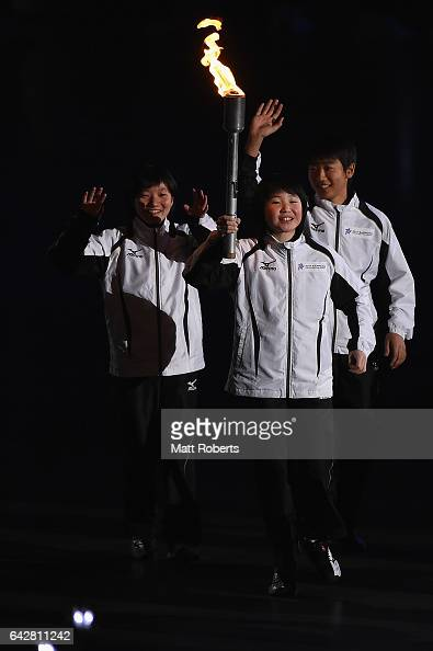 Torch runner Yui Ohzeki accompanied by Sora Ito and Keita Momem during the Opening Ceremony on day two of the 2017 Sapporo Asian Winter Games at...