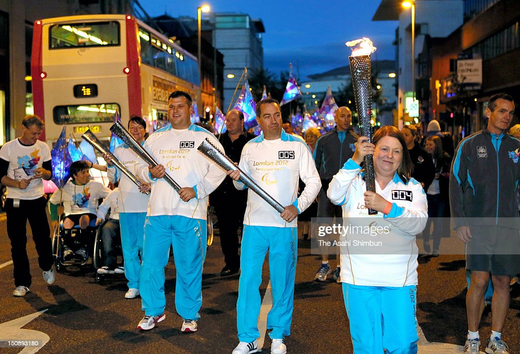 Torchbearers are seen during the 2012 Paralympic torch relay, starting at Belfast on August 25, 2012 in Belfast, Northern Ireland.