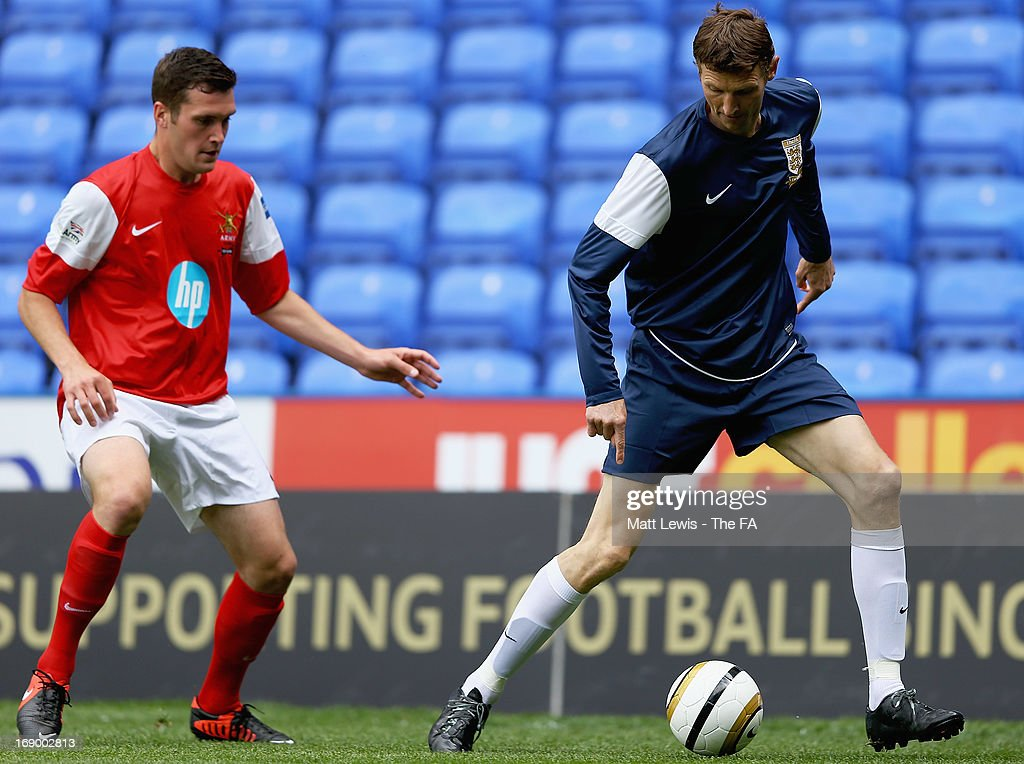 <a gi-track='captionPersonalityLinkClicked' href=/galleries/search?phrase=Tore+Andre+Flo&family=editorial&specificpeople=2366392 ng-click='$event.stopPropagation()'>Tore Andre Flo</a> of the FA legends in action during the Army FA and FA Legends Match at Madejski Stadium on May 18, 2013 in Reading, England.