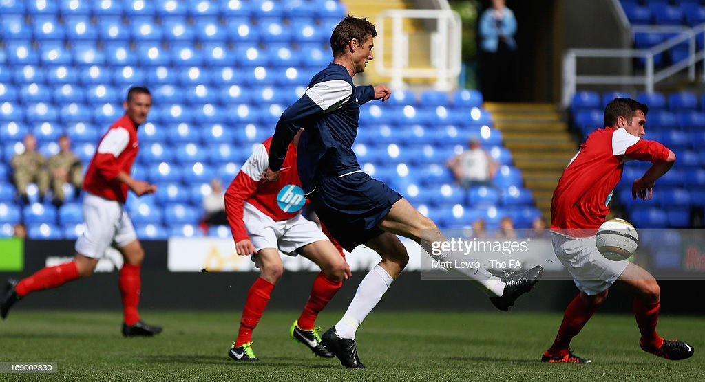 <a gi-track='captionPersonalityLinkClicked' href=/galleries/search?phrase=Tore+Andre+Flo&family=editorial&specificpeople=2366392 ng-click='$event.stopPropagation()'>Tore Andre Flo</a> of the FA legends scores a goal during the Army FA and FA Legends Match at Madejski Stadium on May 18, 2013 in Reading, England.