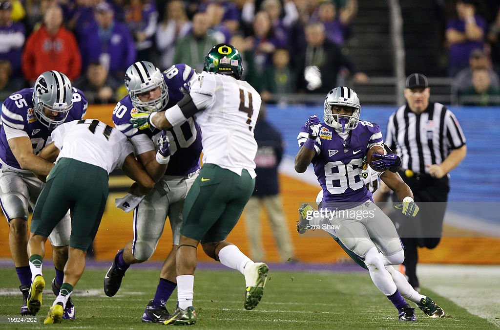 Torell Miller #88 of the Kansas State Wildcats carries the ball against the Oregon Ducks during the Tostitos Fiesta Bowl at University of Phoenix Stadium on January 3, 2013 in Glendale, Arizona.