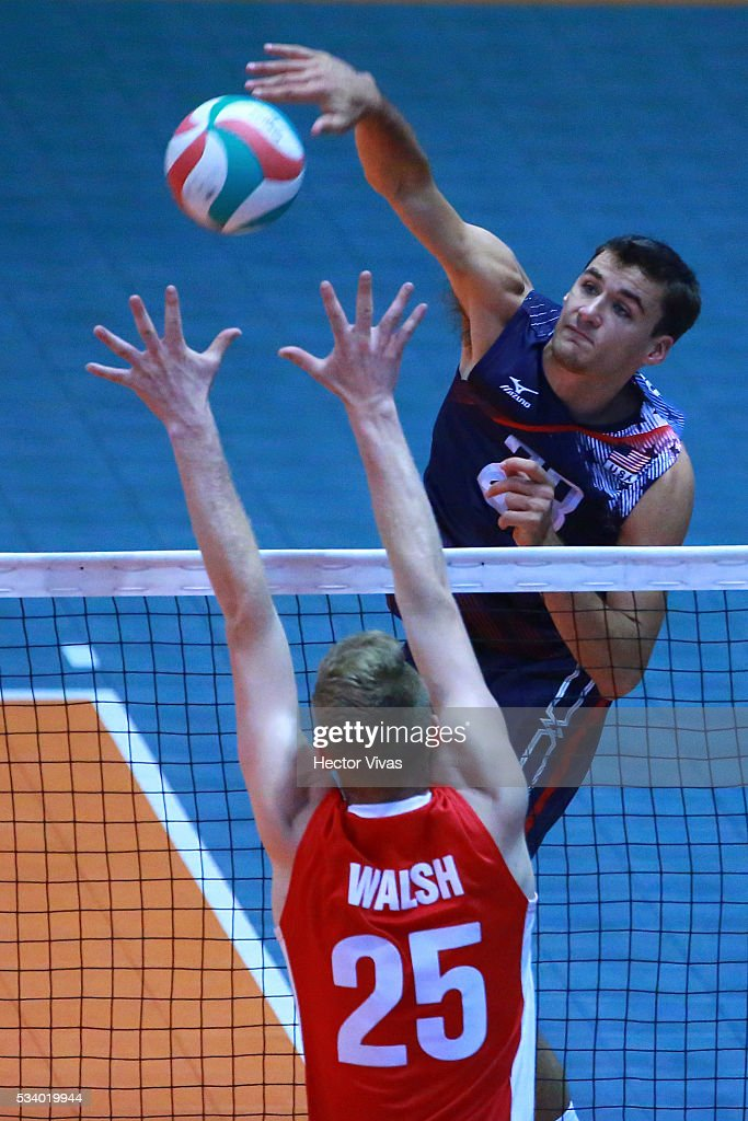 Torey Defalco of United States spikes the ball against Brett Walsh of Canada during a match between USA and Canada as part of Men's Panamerican Volleybal Cup at Gimnasio Ol'mpico Juan de la Barrera on May 24, 2016 in Mexico City, Mexico.