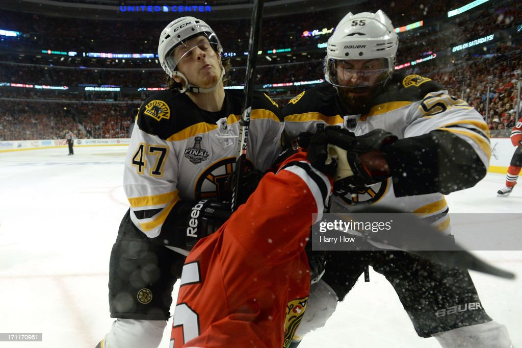 <a gi-track='captionPersonalityLinkClicked' href=/galleries/search?phrase=Torey+Krug&family=editorial&specificpeople=6670036 ng-click='$event.stopPropagation()'>Torey Krug</a> #47 and <a gi-track='captionPersonalityLinkClicked' href=/galleries/search?phrase=Johnny+Boychuk&family=editorial&specificpeople=2125695 ng-click='$event.stopPropagation()'>Johnny Boychuk</a> #55 of the Boston Bruins check Andrew Shaw #65 of the Chicago Blackhawks in Game Five of the 2013 NHL Stanley Cup Final at United Center on June 22, 2013 in Chicago, Illinois.