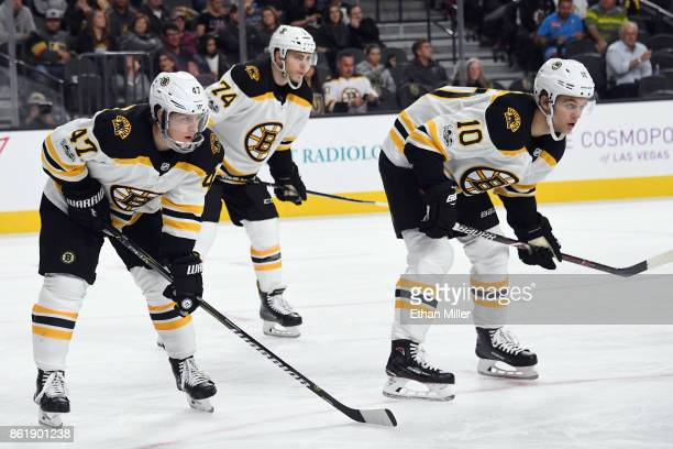 Torey Krug Jake DeBrusk and Anders Bjork of the Boston Bruins wait for a faceoff during the second period of a game against the Vegas Golden Knights...