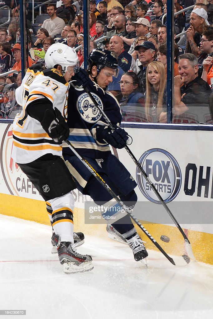 <a gi-track='captionPersonalityLinkClicked' href=/galleries/search?phrase=Torey+Krug&family=editorial&specificpeople=6670036 ng-click='$event.stopPropagation()'>Torey Krug</a> #47 of the Boston Bruins and <a gi-track='captionPersonalityLinkClicked' href=/galleries/search?phrase=Artem+Anisimov&family=editorial&specificpeople=543215 ng-click='$event.stopPropagation()'>Artem Anisimov</a> #42 of the Columbus Blue Jackets battle for possession of the puck during the third period on October 12, 2013 at Nationwide Arena in Columbus, Ohio. Boston defeated Columbus 3-1.