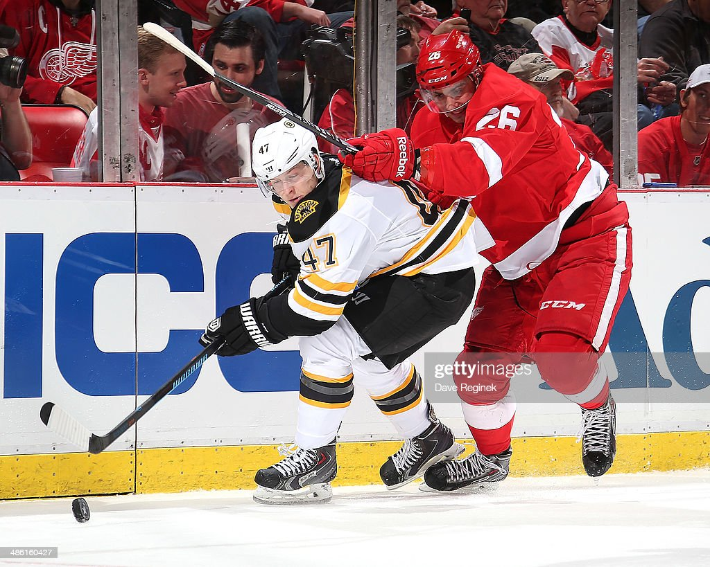 <a gi-track='captionPersonalityLinkClicked' href=/galleries/search?phrase=Torey+Krug&family=editorial&specificpeople=6670036 ng-click='$event.stopPropagation()'>Torey Krug</a> #47 of the Boston Bruins and Tomas Jurco #26 of the Detroit Red Wings battle for the puck during Game Three of the First Round of the 2014 Stanley Cup Playoffs on April 22, 2014 at Joe Louis Arena in Detroit, Michigan. Bruins defeated Detroit 3-0