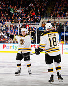 Torey Krug of the Boston Bruins celebrates his goal against the New York Islanders with Reilly Smith during their game at the Nassau Veterans...