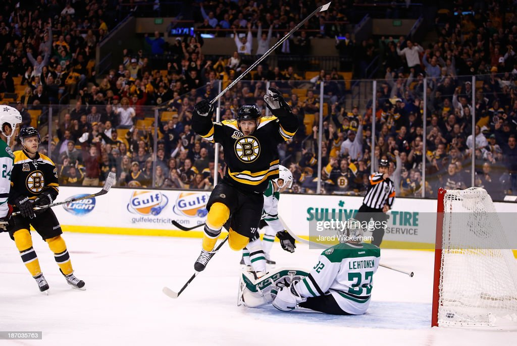 <a gi-track='captionPersonalityLinkClicked' href=/galleries/search?phrase=Torey+Krug&family=editorial&specificpeople=6670036 ng-click='$event.stopPropagation()'>Torey Krug</a> #47 of the Boston Bruins celebrates his goal in the first period in front of <a gi-track='captionPersonalityLinkClicked' href=/galleries/search?phrase=Kari+Lehtonen&family=editorial&specificpeople=211612 ng-click='$event.stopPropagation()'>Kari Lehtonen</a> #32 of the Dallas Stars at TD Garden on November 5, 2013 in Boston, Massachusetts.