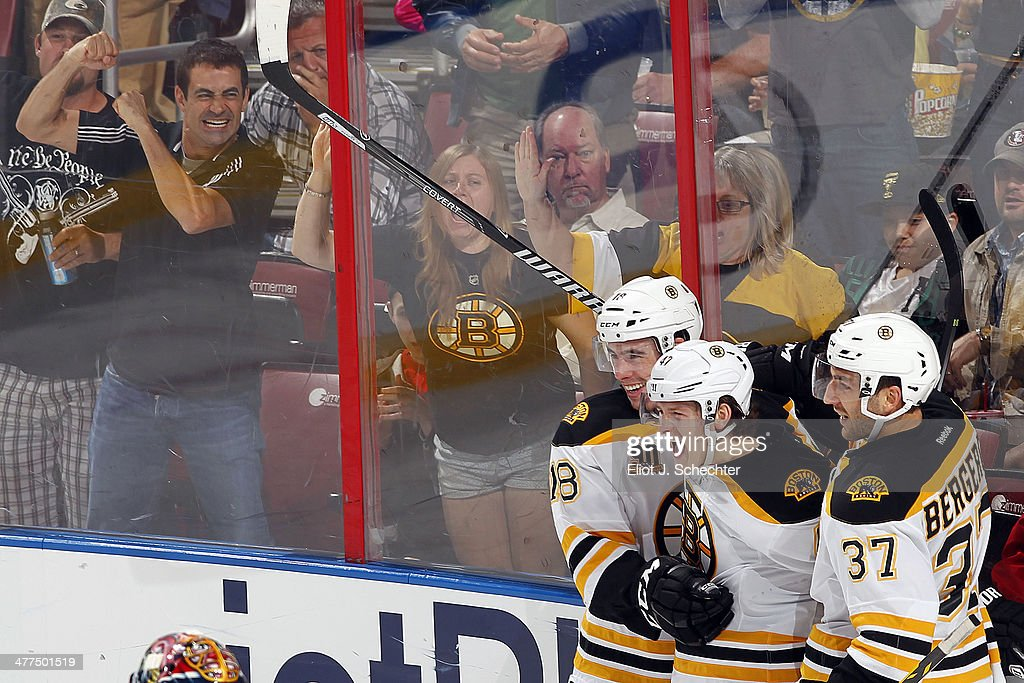 <a gi-track='captionPersonalityLinkClicked' href=/galleries/search?phrase=Torey+Krug&family=editorial&specificpeople=6670036 ng-click='$event.stopPropagation()'>Torey Krug</a> #47 of the Boston Bruins celebrates his goal with teammates Reilly Smith #18 and <a gi-track='captionPersonalityLinkClicked' href=/galleries/search?phrase=Patrice+Bergeron&family=editorial&specificpeople=204162 ng-click='$event.stopPropagation()'>Patrice Bergeron</a> #37 against the Florida Panthers at the BB&T Center on March 9, 2014 in Sunrise, Florida.