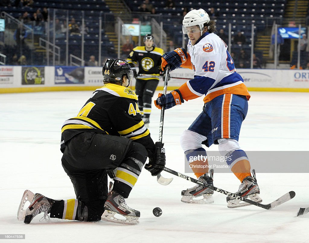 Torey Krug #44 of the Providence Bruins blocks the shot of Brandon DeFazio #42 of the Bridgeport Sound Tigers during overtime of an American Hockey League game on January 31, 2013 at the Webster Bank Arena at Harbor Yard in Bridgeport, Connecticut.