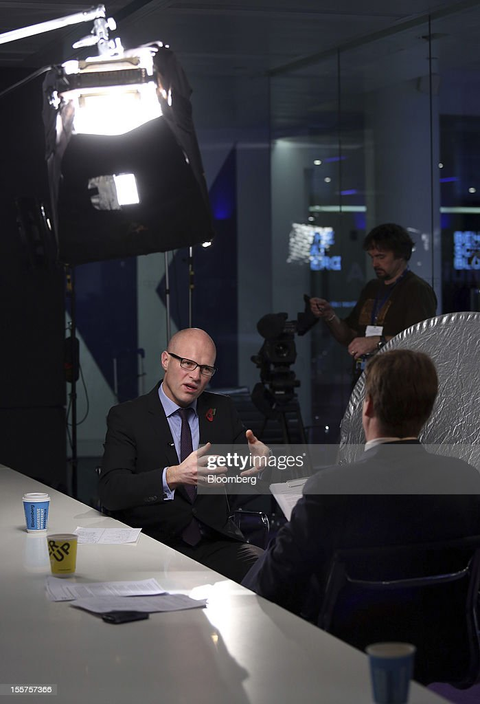 Torgrim Reitan, chief financial officer of Statoil ASA, left, gestures during a Bloomberg television interview in London, U.K., on Wednesday, Nov. 7, 2012. Statoil has seen overseas costs rise as it expands in countries such as the U.S., Angola and Brazil to counter falling production from aging fields off Norway. Photographer: Chris Ratcliffe/Bloomberg via Getty Images