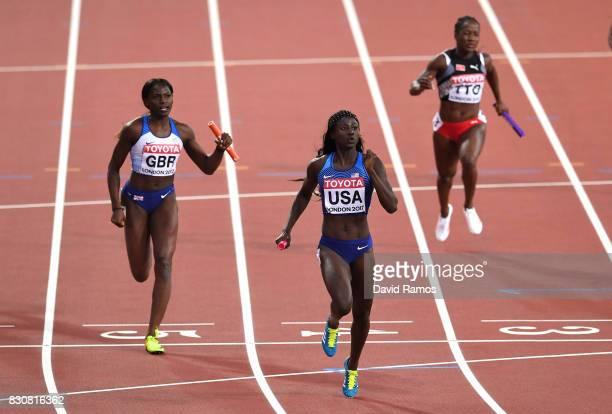 Tori Bowie of the United States and Daryll Neita of Great Britain race to the finish line in the Women's 4x100 Metres Final during day nine of the...