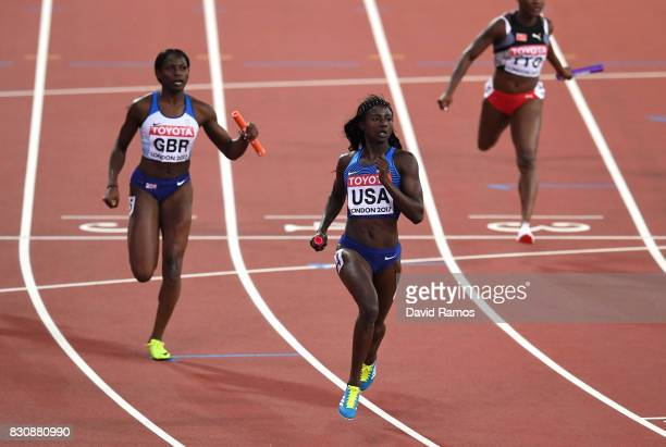 Tori Bowie of the United States and Daryll Neita of Great Britain race to the finish line in the Women's 4x400 Metres Final during day nine of the...