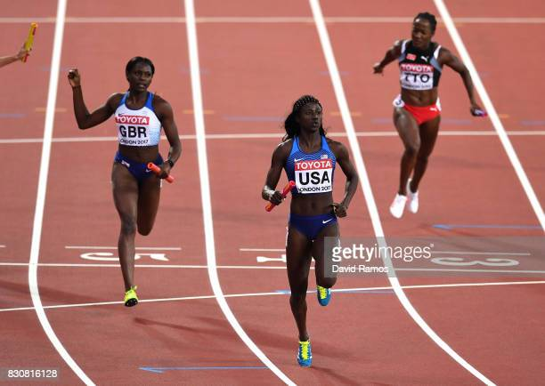 Tori Bowie of the United States crosses the finish line to win gold in the Women's 4x400 Metres Final ahead of Daryll Neita of Great Britain during...