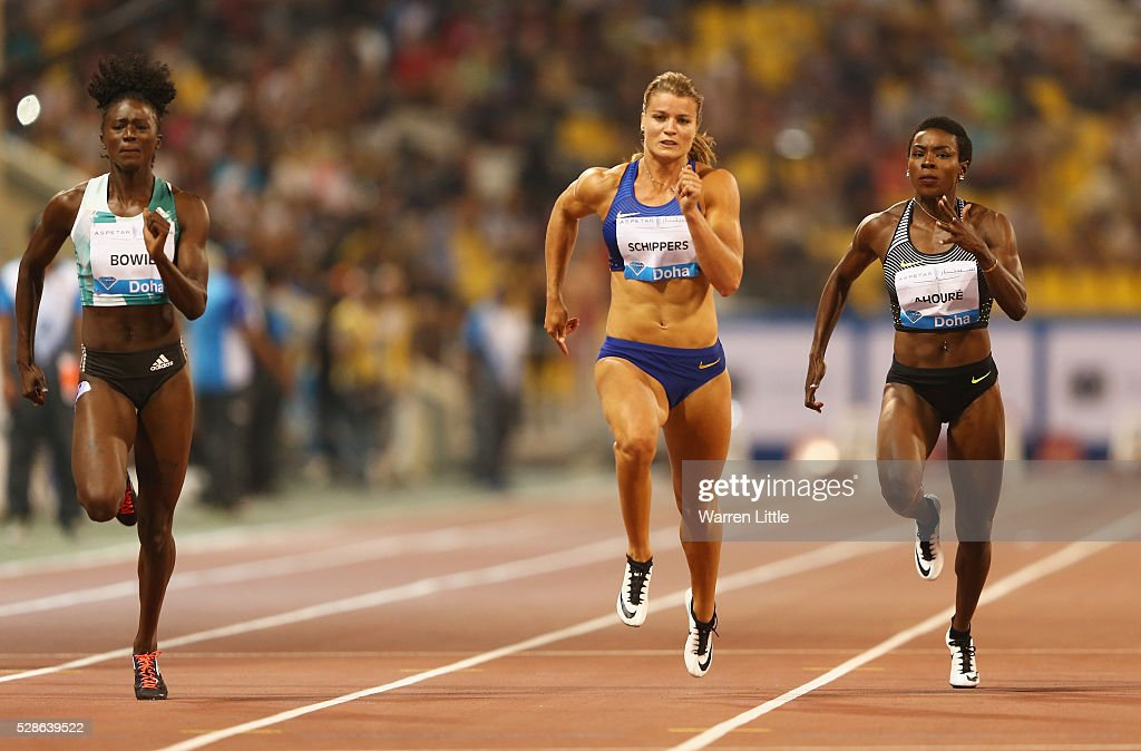 Tori Bowie of the United States, Dafne Schippers of the Netherlands and Murielle Ahoure of the Ivory Coast compete in the Women's 100 metres final during the Doha IAAF Diamond League 2016 meeting at Qatar Sports Club on May 6, 2016 in Doha, Qatar.